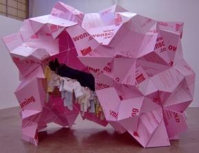 Dream Hut, 2007; pink residing board, glue, domestic fabrics, rope, metal; 8' x 5' x 7'