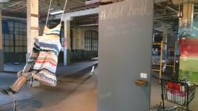 Held/Hold, 2017; worn clothes, rope, chain, plywood
