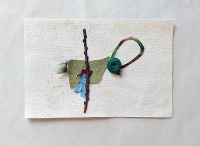 "Hog Body, 2020; fabric, paper, pine branch, paint; 4"" X 6"""